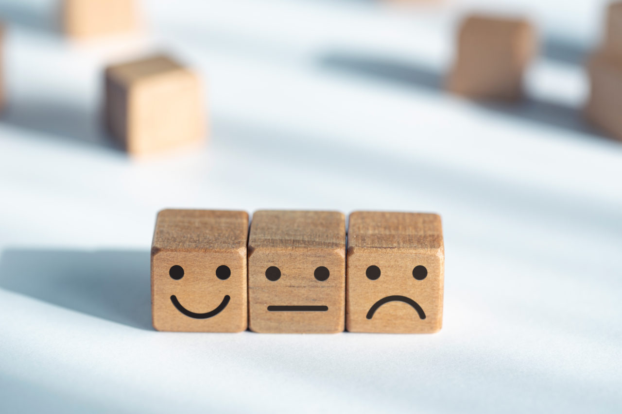 Service evaluation concept. Feedback rating. Smiley icon on wooden dice